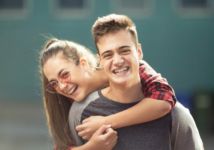 Two teenagers laughing